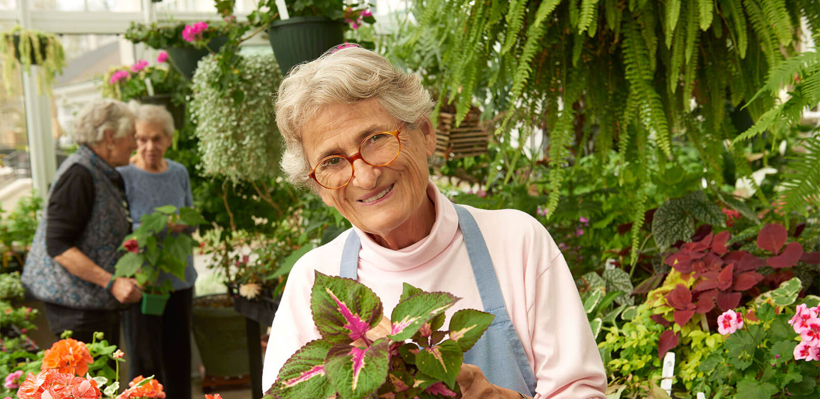 Residents prepare and care for plants at the Foulkeways Conservatory